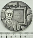 Medal Jan Paweł II Ad Universam